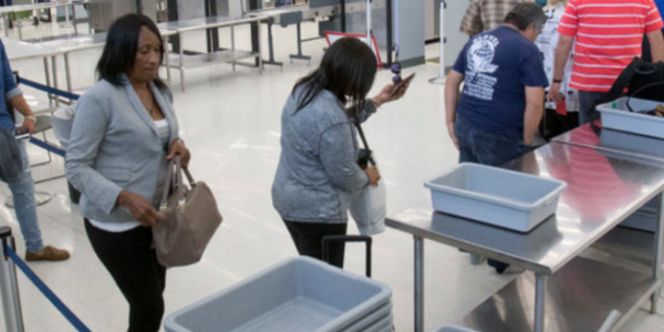 Airport security trays dirtier than toilet seat